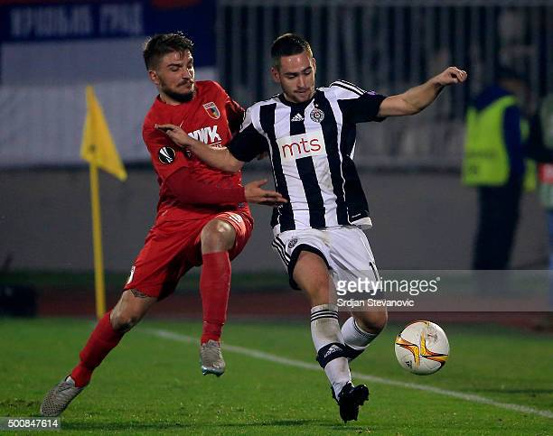 Andrija Zivkovic of FK Partizan in action against Kostas Stafylidis of FC Augsburg during the UEFA Europa League match between FK Partizan v FC...