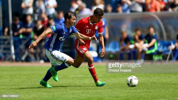 Andriko Smolinski of Schalke challenges Oliver Batista Meier of Bayern during the B Juniors German Championship Semi Final match between FC Schalke...
