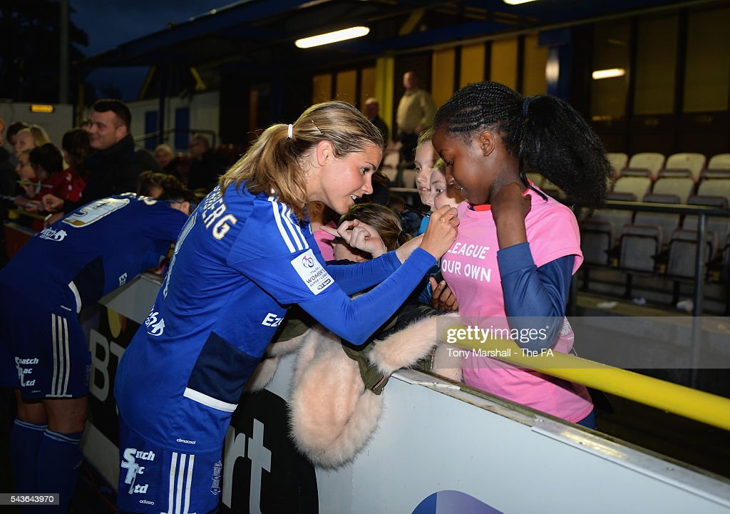 Andrine Hegerberg of Birmingham City Ladies signs a fans shirts after the WSL match between Birmingham City Ladies and Arsenal Ladies FC at Automated Technology Stadium on June 29, 2016 in Solihull, England.