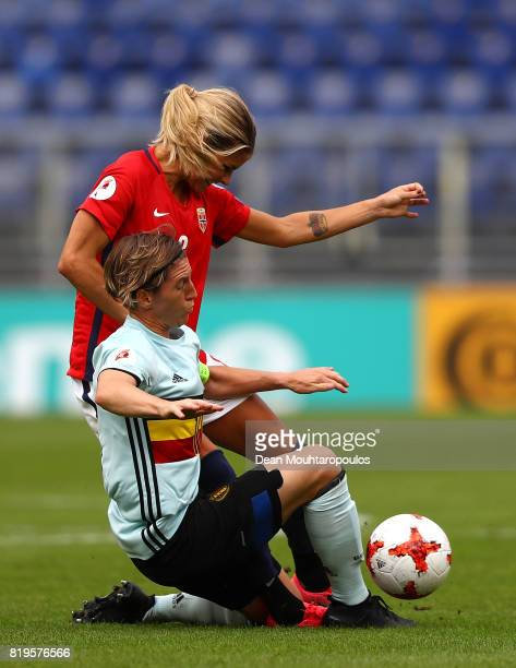 Andrine Hegerberg of Norway is tackled by Aline Zeler of Belgium during the UEFA Women's Euro 2017 Group A match between Norway and Belgium at Rat...