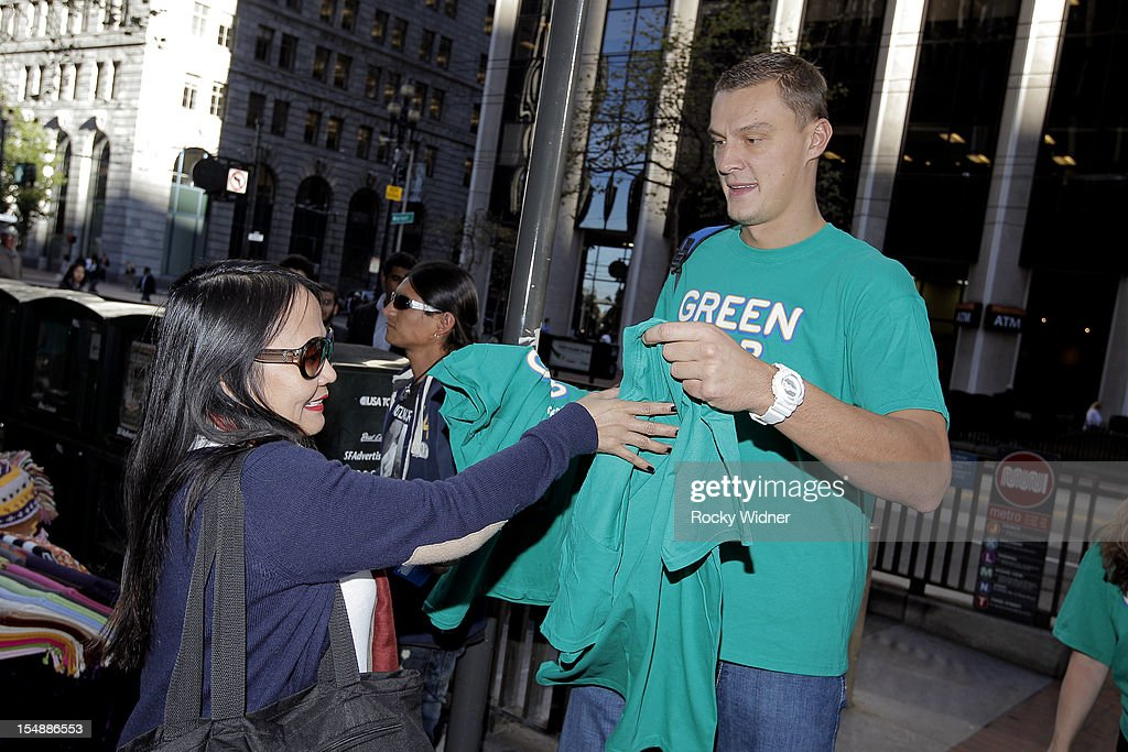 Andris Biedrins of the Golden State Warriors hands out free T shirts to fans on October 26, 2012 in Oakland, California.