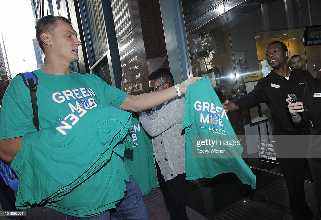 Andris Biedrins of the Golden State Warriors hands out free t shirts on October 26, 2012 in Oakland, California.