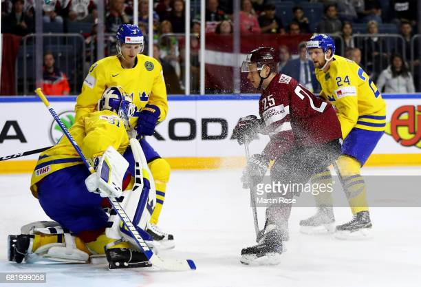 Andris Dzerins of Latvia fails to score over Eddie Lack goaltender of Sweden during the 2017 IIHF Ice Hockey World Championship game between Sweden...