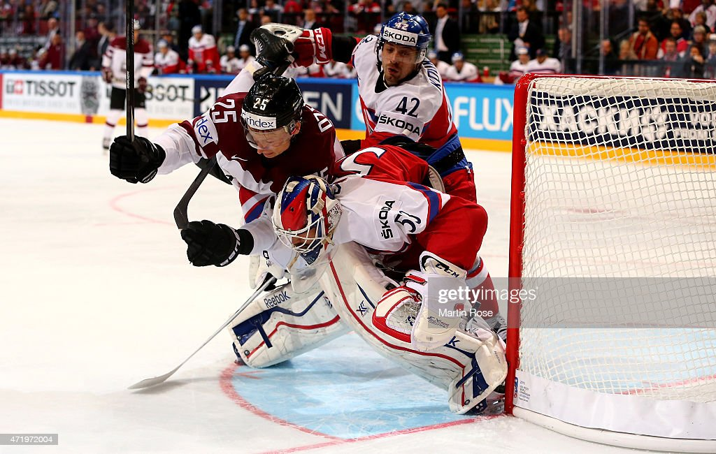 Andris Dzernis (L) of Latvia and fails to score over Alexander Salak, goaltender of Czech Republic during the IIHF World Championship group A match between Latvia and Czech Republic at o2 Arenaon May 2, 2015 in Prague, Czech Republic.
