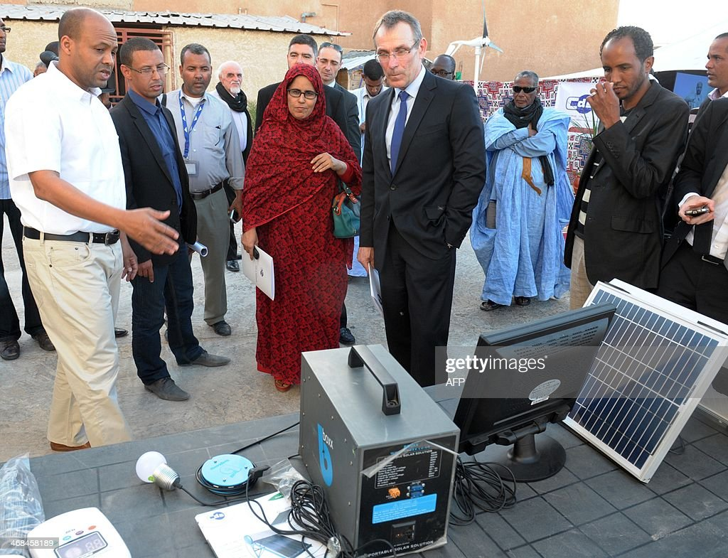 Andris Piebalgs center attends an exhibition solar thermal energy