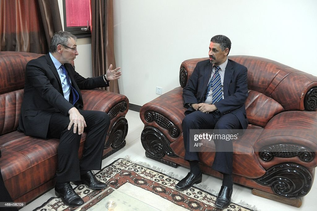 Andris Piebalgs left confers with Sidi Ould Tah Mauritanian Minister for Economic Affairs and Cooperation