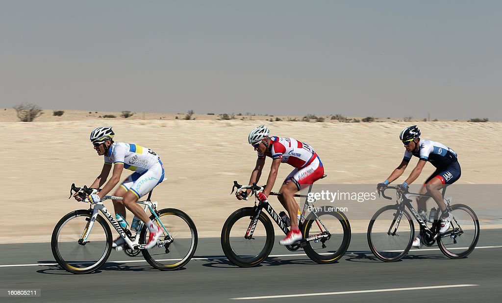 Andriy Grivko of Astana and the Ukriaine leads Gatis Smukulis of Katusha and Latvia and Pirmin Lang of Switzerland and IAM Cycling during stage four of the Tour of Qatar from Camel Race Track to Al Khor Corniche on February 6, 2013 near Camel Race Track, Qatar.