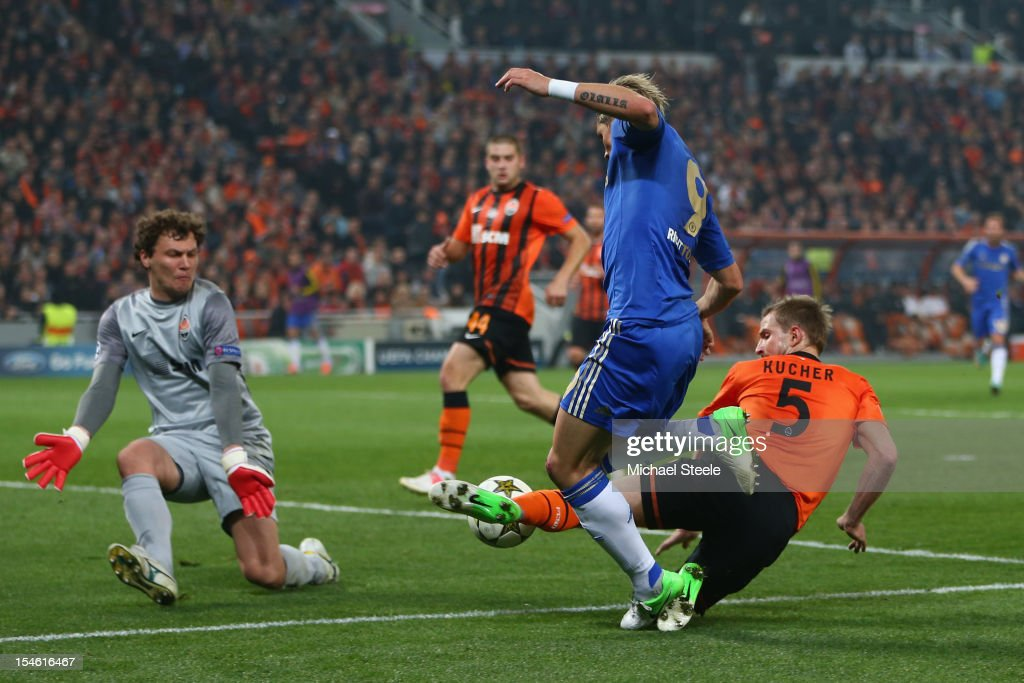 Andriy Pyatov (L) and defender Olexandr Kucher (R) of Shakhtar Donetsk block a shot from Fernando Torres (C) of Chelsea during the UEFA Champions League Group E match between Shakhtar Donetsk and Chelsea at the Donbass Arena on October 23, 2012 in Donetsk, Ukraine.