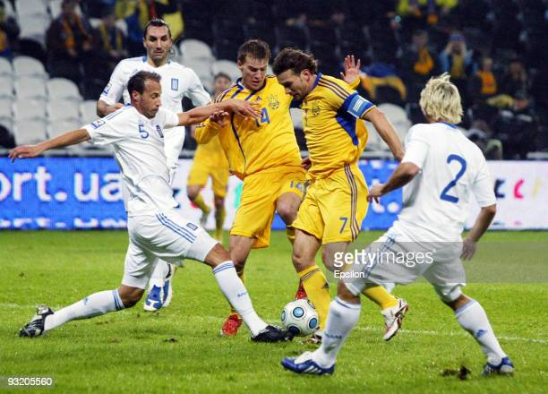 Andriy Shevchenko and Andriy Yarmolenko of Ukraine are challenged by Vassilis Pliatsikas and Evangelos Moras of Greece during the 2010 FIFA World Cup...