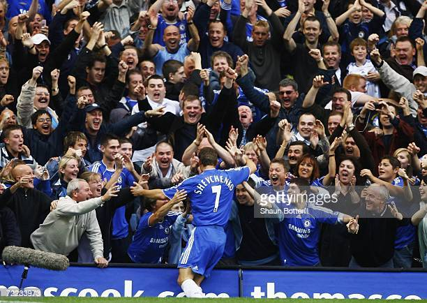 Andriy Shevchenko of Chelsea celebrates with fans as he scores the first goal during the Barclays Premiership match between Chelsea and Portsmouth at...