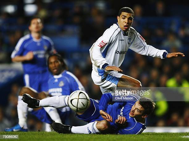 Andriy Shevchenko of Chelsea challenges Scott Golbourne of Wycombe Wanderers during the Carling Cup Semi Final 2nd leg match between Chelsea and...