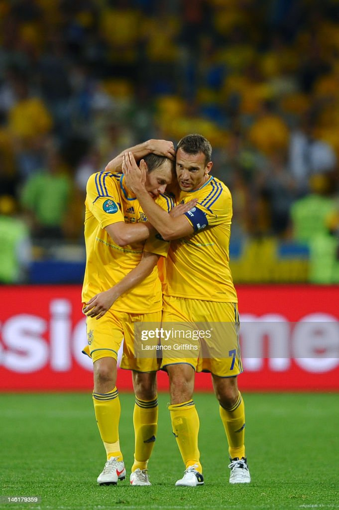 <a gi-track='captionPersonalityLinkClicked' href=/galleries/search?phrase=Andriy+Shevchenko&family=editorial&specificpeople=220501 ng-click='$event.stopPropagation()'>Andriy Shevchenko</a> of Ukraine celebrates scoring their first goal with Oleh Husyev of Ukraine during the UEFA EURO 2012 group D match between Ukraine and Sweden at The Olympic Stadium on June 11, 2012 in Kiev, Ukraine.