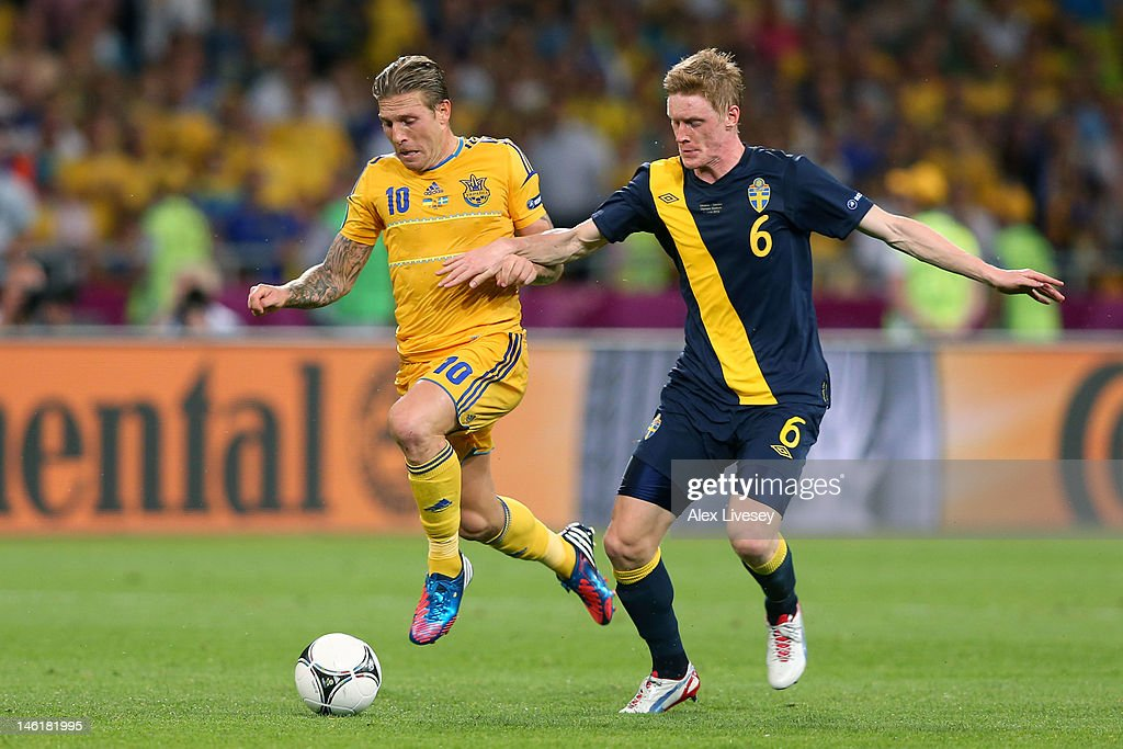 Andriy Voronin of Ukraine and Rasmus Elm of Sweden during the UEFA EURO 2012 group D match between Ukraine and Sweden at The Olympic Stadium on June...