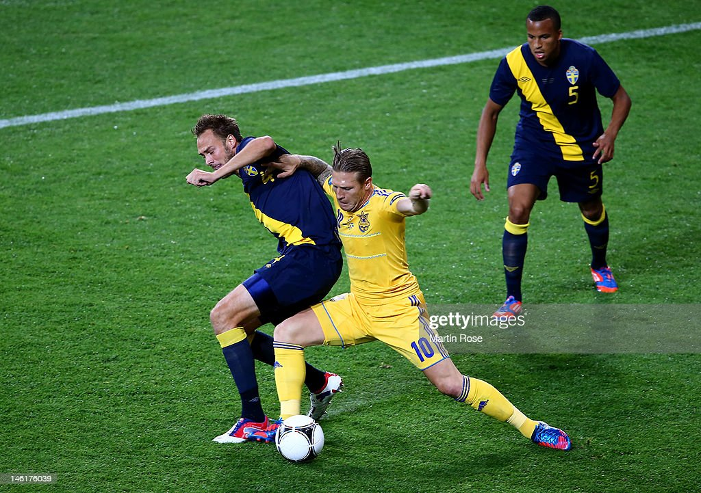 Andriy Voronin of Ukraine battles for the ball with Andreas Granqvist of Sweden during the UEFA EURO 2012 group D match between Ukraine and Sweden at...