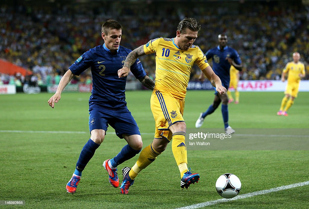 Andriy Voronin of Ukraine holds off Mathieu Debuchy of France during the UEFA EURO 2012 group D match between Ukraine and France at Donbass Arena on...