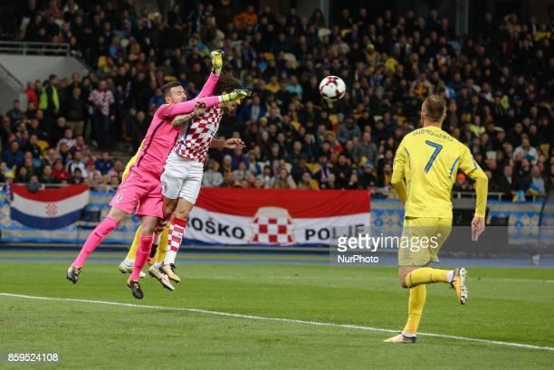 Andriy Yarmolenko and Sime Vrsaljko of Ukraine in action against Croatian goalkeeper Danijel Subasic during the FIFA 2018 World Cup Group I Qualifier...