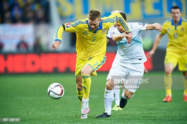 Andriy Yarmolenko from Ukraine fights for the ball with Bojan Jokic of Slovenia during the UEFA EURO 2016 Playoff for Final Tournament First leg...