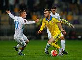 Andriy Yarmolenko of Ukraine battles with Valter Birsa of Slovenia during the UEFA EURO 2016 qualifier playoff second leg match between Slovenia and...