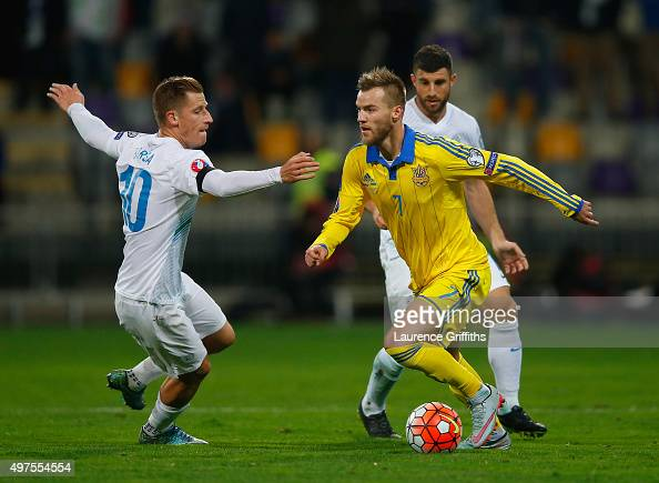 Andriy Yarmolenko of Ukraine battles with Valter Birsa of Slovenia during the UEFA EURO 2016 qualifier playoff second leg match between Slovenia and...