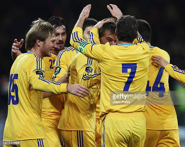 Andriy Yarmolenko of Ukraine celebrates with his team mates after scoring his team's first goal during the International Friendly match between...