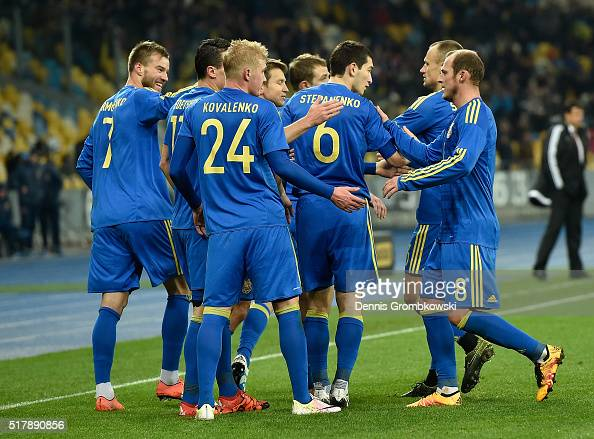 Andriy Yarmolenko of Ukraine celebrates with team mates as he scores the opening goal during the International Friendly match between Ukraine and...