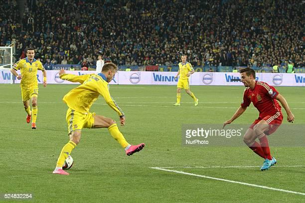 Andriy Yarmolenko of Ukraine national team vies with C��sar Azpilicueta of Spain during the European Qualifiers 2016 match between Ukraine and Spain...