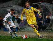 Andriy Yarmolenko of Ukraine skips past Valter Birsa of Slovenia during the UEFA EURO 2016 qualifier playoff second leg match between Slovenia and...