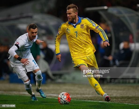 Andriy Yarmolenko of Ukraine skips past Valter Birsa of Slovenia during the UEFA EURO 2016 qualifier playoff second leg match between Slovenia and...