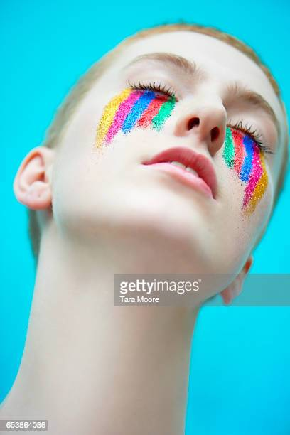androgynous woman with rainbow makeup