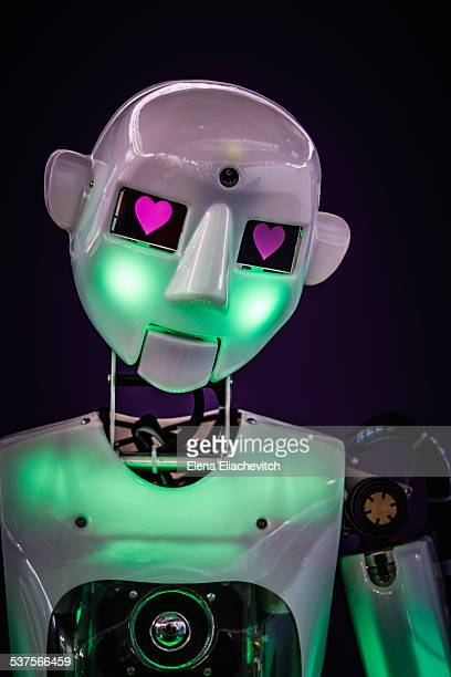 Android robot with hearts in it's eyes