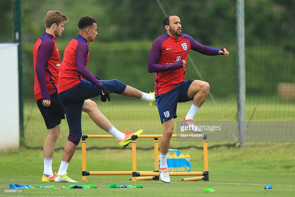 <a gi-track='captionPersonalityLinkClicked' href=/galleries/search?phrase=Andros+Townsend&family=editorial&specificpeople=4266573 ng-click='$event.stopPropagation()'>Andros Townsend</a>, <a gi-track='captionPersonalityLinkClicked' href=/galleries/search?phrase=Dele+Alli&family=editorial&specificpeople=9976958 ng-click='$event.stopPropagation()'>Dele Alli</a> and <a gi-track='captionPersonalityLinkClicked' href=/galleries/search?phrase=Eric+Dier&family=editorial&specificpeople=9440610 ng-click='$event.stopPropagation()'>Eric Dier</a> of England warm up during an England training session at St Georges Park on May 30, 2016 in Burton on Trent, England.