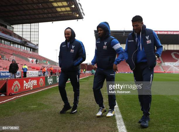 Andros Townsend Jason Puncheon and Patrick van Aanholt of Crystal Palace leave after inspecting a pitch prior to the Premier League match between...