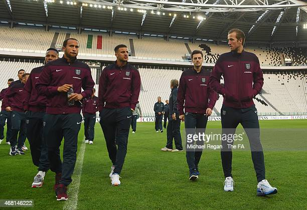 Andros Townsend Kyle Walker Ryan Mason and Harry Kane of England inspect the pitch during an England team stadium visit ahead of the International...