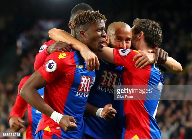 Andros Townsend of Crystal Palace celebrates with Wilfried Zaha and Yohan Cabaye as he scores their first goal during the Premier League match...