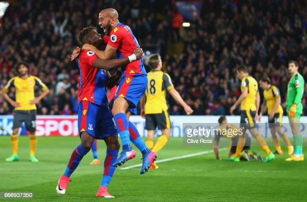 Andros Townsend of Crystal Palace celebrates with Wilfried Zaha of Crystal Palace as he scores their first goal during the Premier League match...