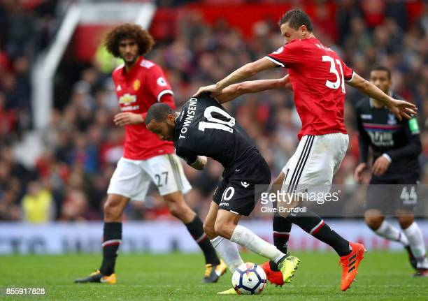 Andros Townsend of Crystal Palace controls the ball under pressure of Nemanja Matic of Manchester United during the Premier League match between...