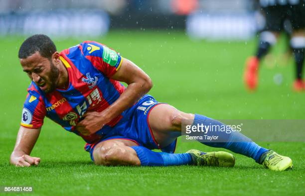 Andros Townsend of Crystal Palace lays on the ground holding his stomach during the Premier League match between Newcastle United and Crystal Palace...