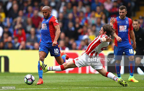 Andros Townsend of Crystal Palace takes it past Joe Allen of Stoke City as he attempts to slide him during the Premier League match between Crystal...