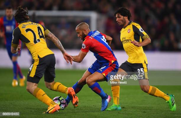 Andros Townsend of Crystal Palace takes on Mohamed Elneny and Hector Bellerin of Arsenal during the Premier League match between Crystal Palace and...