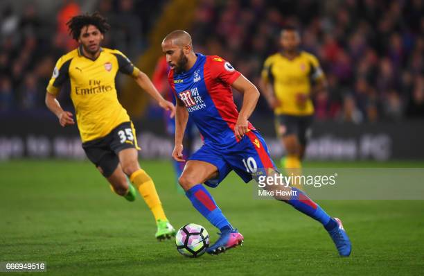 Andros Townsend of Crystal Palace takes on Mohamed Elneny of Arsenal during the Premier League match between Crystal Palace and Arsenal at Selhurst...
