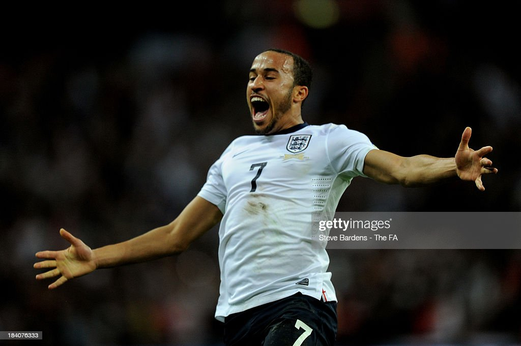 <a gi-track='captionPersonalityLinkClicked' href=/galleries/search?phrase=Andros+Townsend&family=editorial&specificpeople=4266573 ng-click='$event.stopPropagation()'>Andros Townsend</a> of England celebrates after scoring his team's third goal during the FIFA 2014 World Cup Qualifying Group H match between England and Montenegro at Wembley Stadium on October 11, 2013 in London, England.
