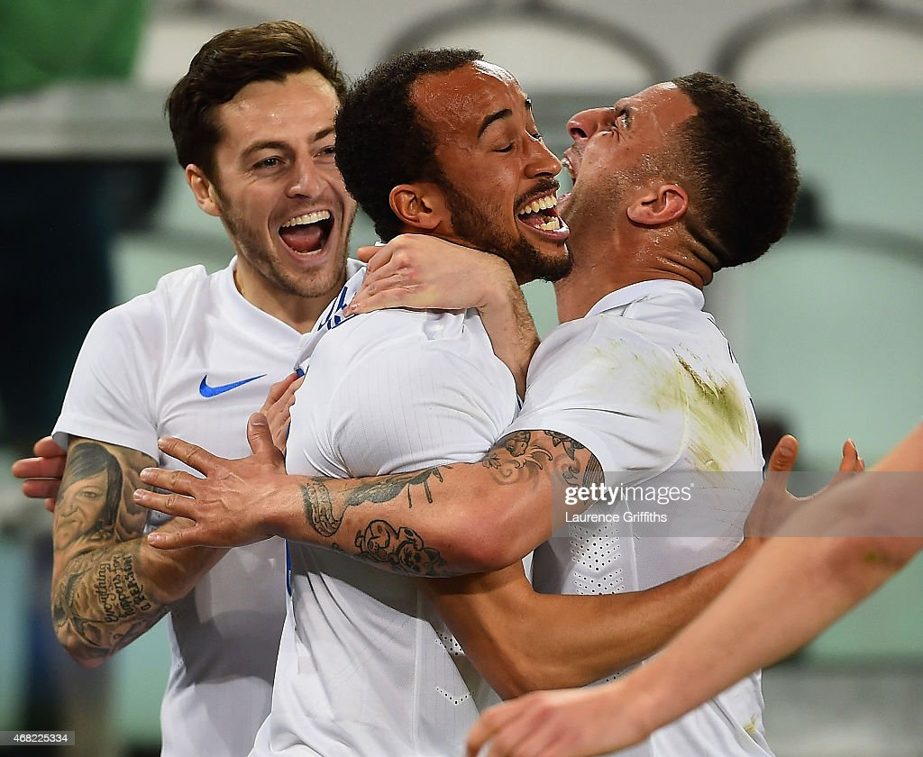 Andros Townsend of England celebrates scoring their first goal with Ryan Mason and Kyle Walker of England during the international friendly match between Italy and England at the Juventus Arena on March 31, 2015 in Turin, Italy.