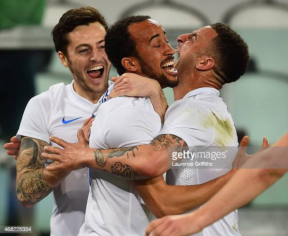 Andros Townsend of England celebrates scoring their first goal with Ryan Mason and Kyle Walker of England during the international friendly match...