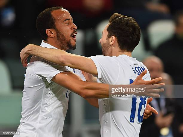 Andros Townsend of England celebrates scoring their first goal with Ryan Mason of England during the international friendly match between Italy and...