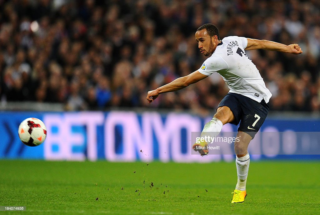 <a gi-track='captionPersonalityLinkClicked' href=/galleries/search?phrase=Andros+Townsend&family=editorial&specificpeople=4266573 ng-click='$event.stopPropagation()'>Andros Townsend</a> of England scores their third goal during the FIFA 2014 World Cup Qualifying Group H match between England and Montenegro at Wembley Stadium on October 11, 2013 in London, England.
