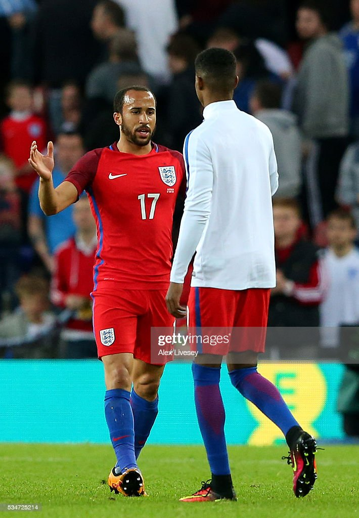 <a gi-track='captionPersonalityLinkClicked' href=/galleries/search?phrase=Andros+Townsend&family=editorial&specificpeople=4266573 ng-click='$event.stopPropagation()'>Andros Townsend</a> of England shakes hands with team mate <a gi-track='captionPersonalityLinkClicked' href=/galleries/search?phrase=Marcus+Rashford&family=editorial&specificpeople=13847707 ng-click='$event.stopPropagation()'>Marcus Rashford</a> following the International Friendly match between England and Australia at Stadium of Light on May 27, 2016 in Sunderland, England.