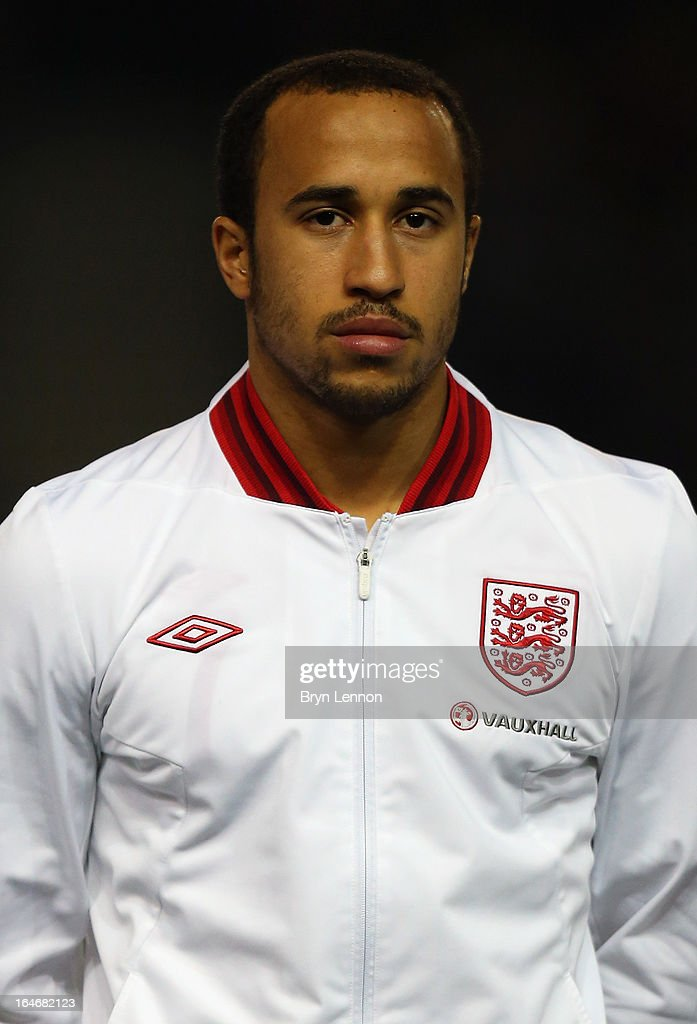 Andros Townsend of England stands for the national athems ahead during the International Friendly match between England U21 and Austria U21 at Amex Stadium on March 25, 2013 in Brighton, England.