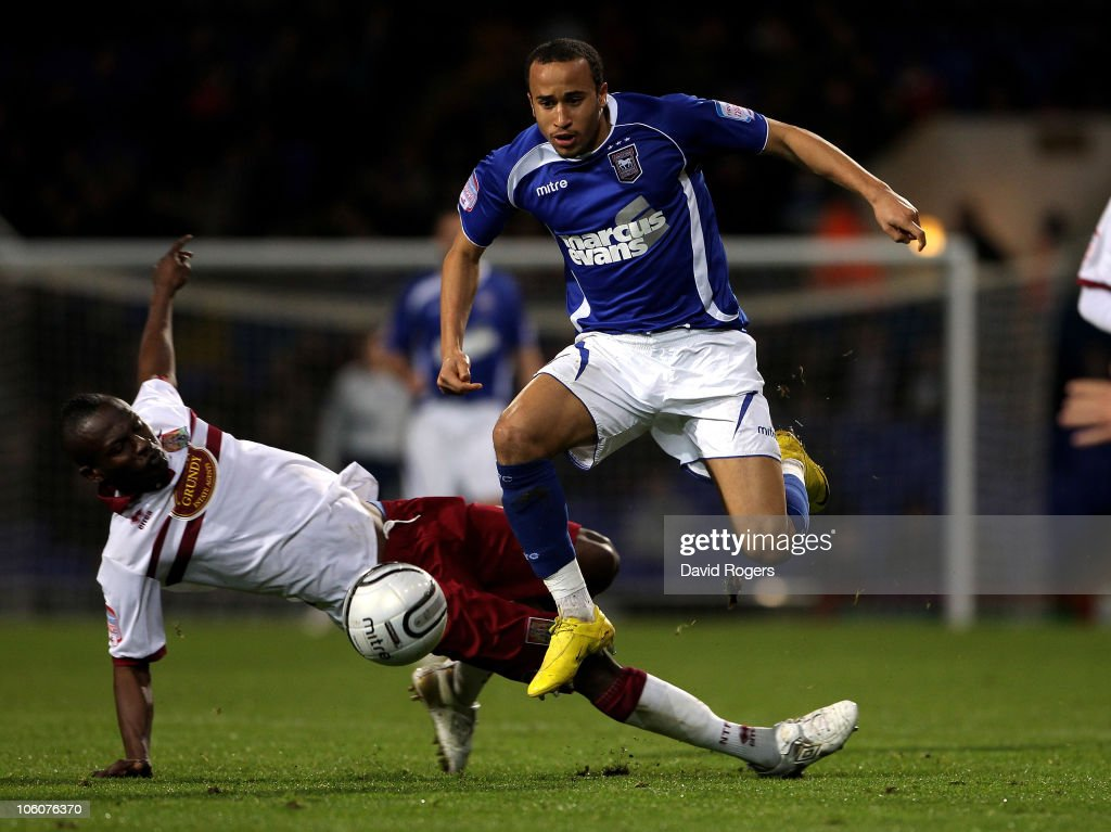 Andros Townsend of Ipswich Town moves away from Abdul Osman during the Carling Cup fourth round match between Ipswich Town and Northampton Town at Portman Road on October 26, 2010 in Ipswich, England.