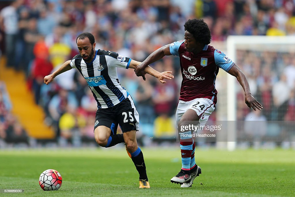 Andros Townsend of Newcastle United and Carlos Sanchez of Aston Villa compete for the ball during the Barclays Premier League match between Aston...