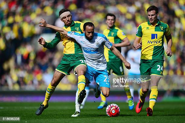 Andros Townsend of Newcastle United and Gary O'Neil of Norwich City compete for the ball during the Barclays Premier League match between Norwich...
